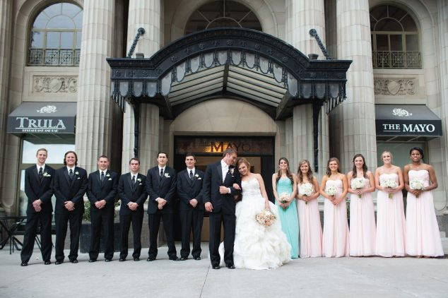 couple and bridal party outside of mayo hotel
