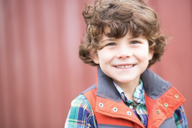 smiling young boy in vest
