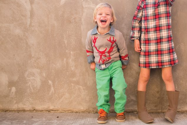 laughing young boy with green pants