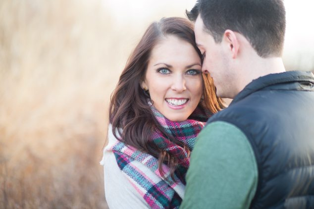 smiling couple with blanket scarf