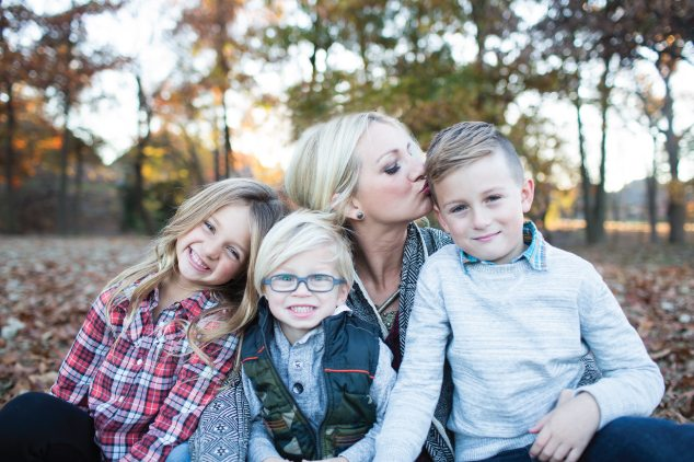 mom with kids kissing son