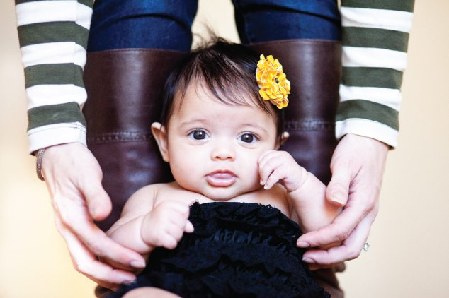 baby with yellow flower in hair