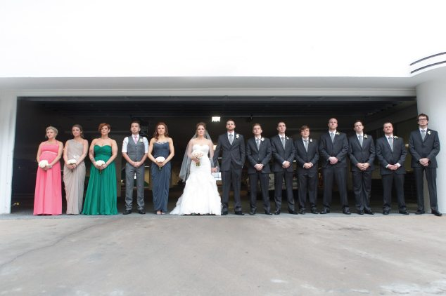 couple standing with bridal party