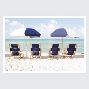 ocean with blue and white beach chairs
