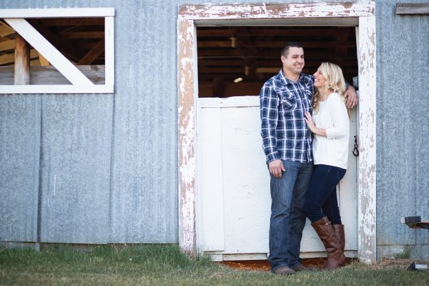 engagement picture by barn