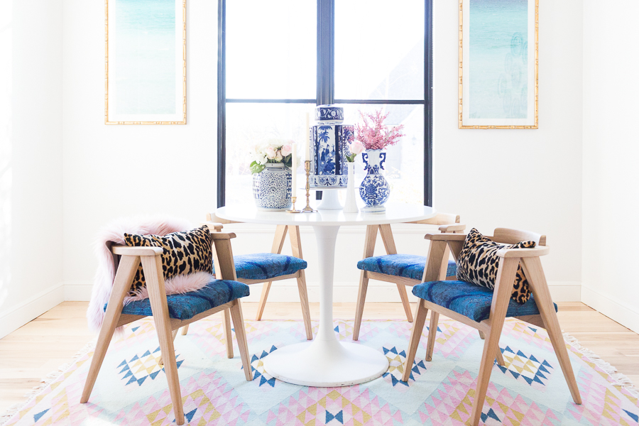 Rooms We Love Home Tour Navy and Pink Modern Glam Breakfast Nook Glittler Guide elodie rug blue and white tabletop vases gold candlesticks black windows wishbone chairs white round table colorful dining room rugs-3.jpg-1.jpg