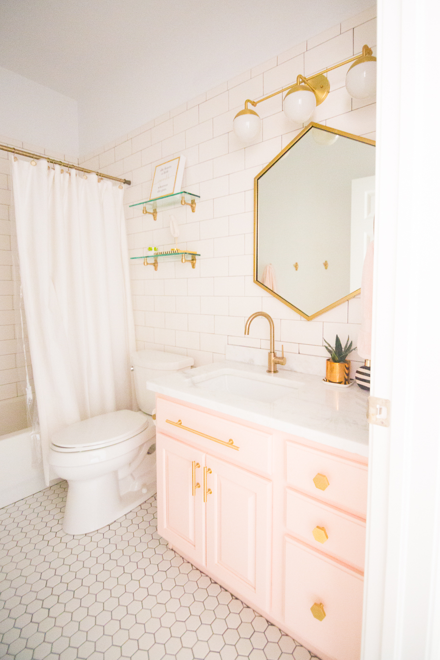 Modern Glam Blush S Bathroom Design Gold Hexagon Mirror Cabinets Hardware White Floor