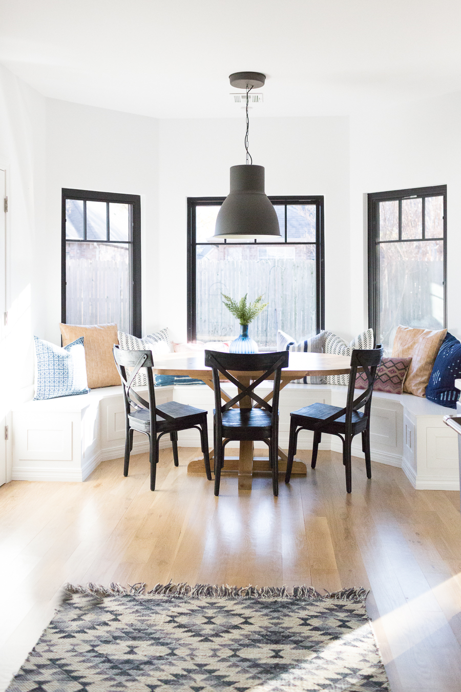 Tulsa Remodel Reveal Modern White Farmhouse black windows and doors black windows and doors built in window seat banquette dining room black pendant lighting-1