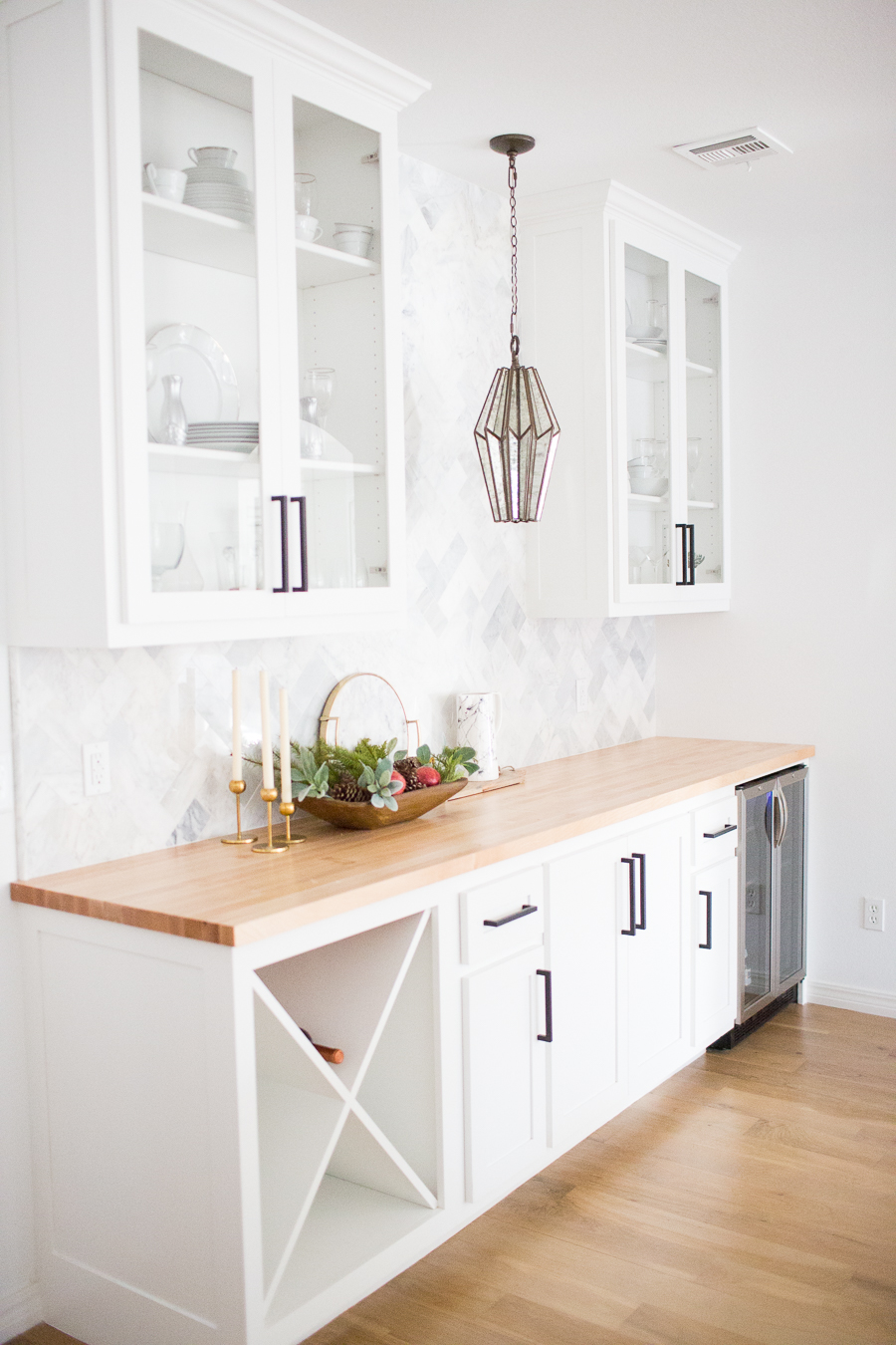 Tulsa Remodel Reveal Modern White Farmhouse black windows and doors marble herringbone backsplash bar butcher block countertop white cabinets black hardware bar faceted pendant lighting-1-3