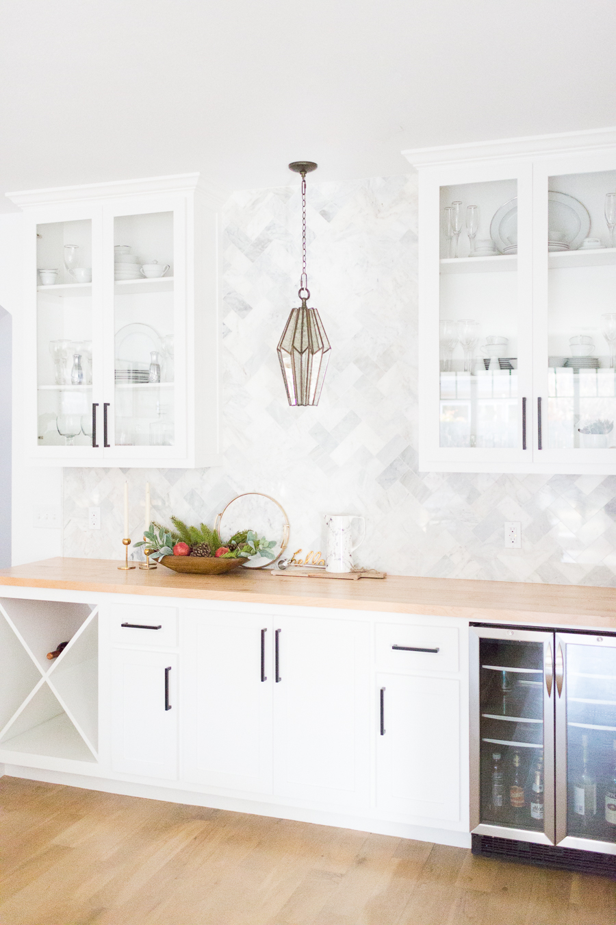 Tulsa Remodel Reveal Modern White Farmhouse black windows and doors marble herringbone backsplash bar butcher block countertop white cabinets black hardware bar faceted pendant lighting-1-4