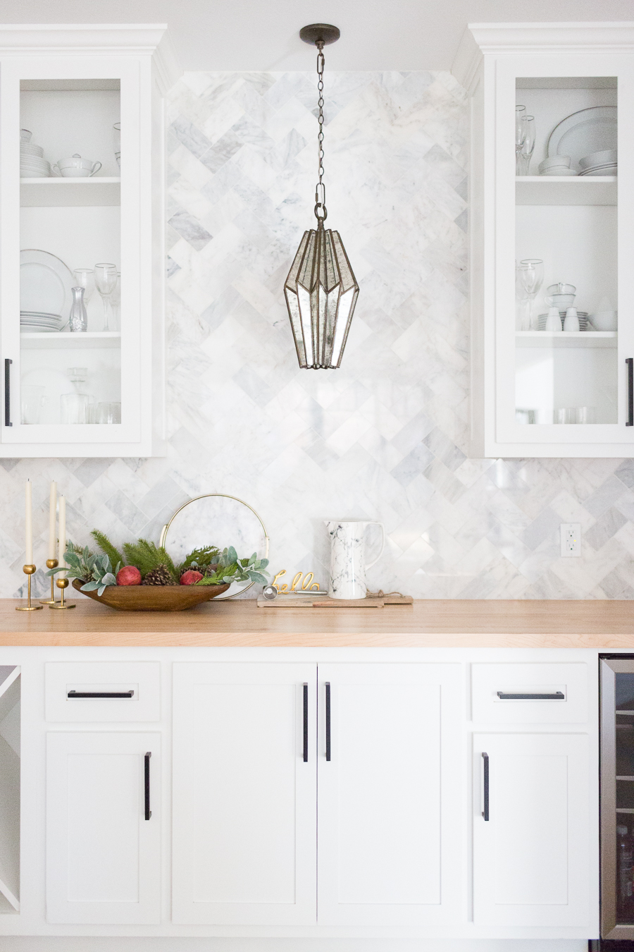 Tulsa Remodel Reveal Modern White Farmhouse black windows and doors marble herringbone backsplash bar butcher block countertop white cabinets black hardware bar faceted pendant lighting-1