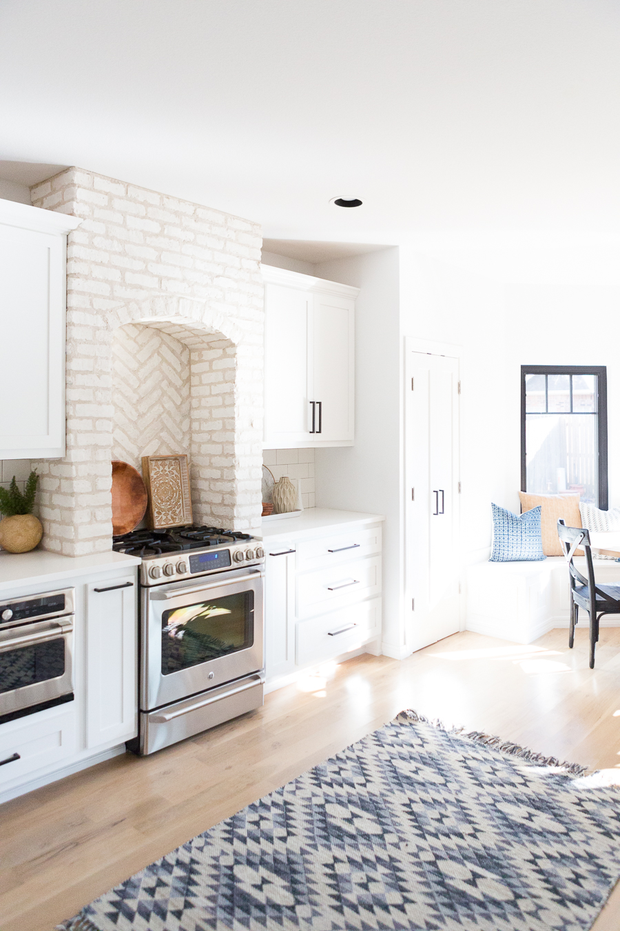 Tulsa Remodel Reveal Modern White Farmhouse black windows and doors white brick kitchen black hardware-1-2