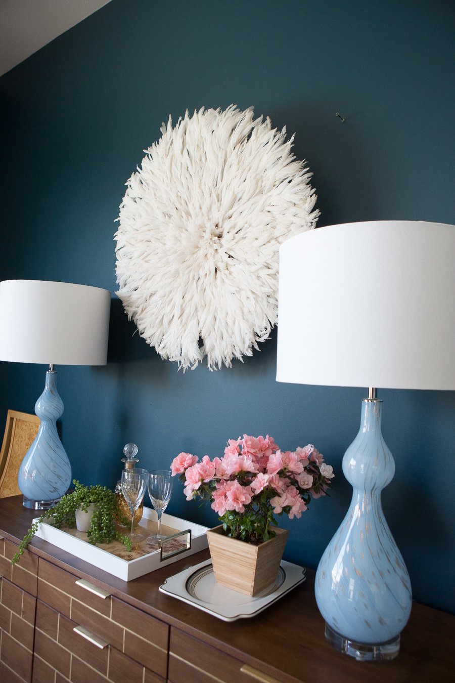 How to Use a Juju Hat in Home Decor dark green painted walls blue cascade lamps dining room credenza styling