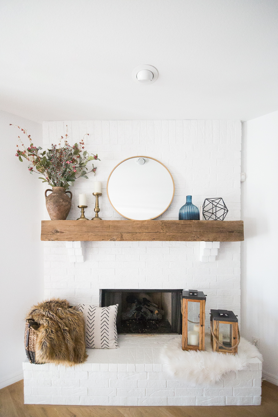 White painted brick fireplace makeover cc and mike - How to make a brick fireplace look modern ...