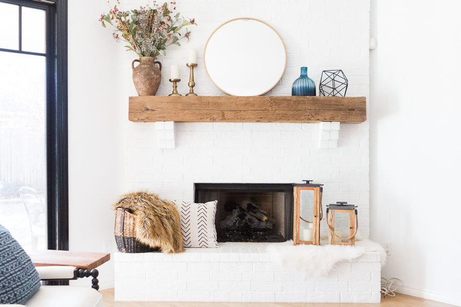 White Painted Brick Fireplace Makeover TV collage wall pottery barn wood media console article sven leather sofa faux fiddle leaf fig tree wood lanterns round gold mirror fireplace styling white walls black windows