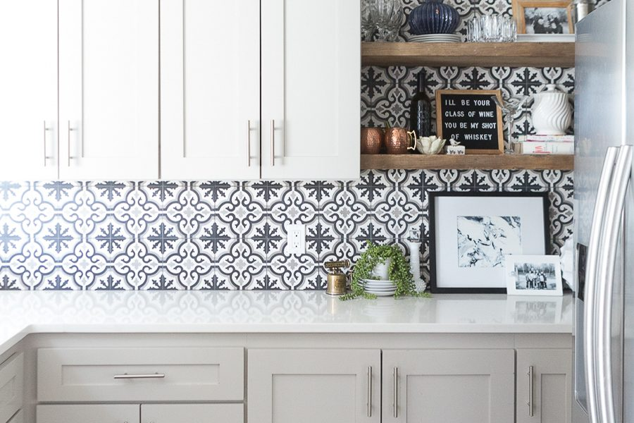 Affordable Ceramic Patterned Tile Backsplash affordable cement tile lookalike black and white patterned tile backsplash open wood shelves kitchen open wood shelves styling ideas how to style open wood shelving blue west elm vase wooden picture frames greige cabinets