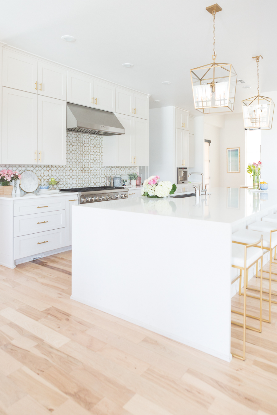 Affordable Ceramic Patterned Tile Backsplash affordable modern gold bar stools white kitchen with gold hardware design ideas patterned tile backsplash kitchen gold kitchen lantern lighting
