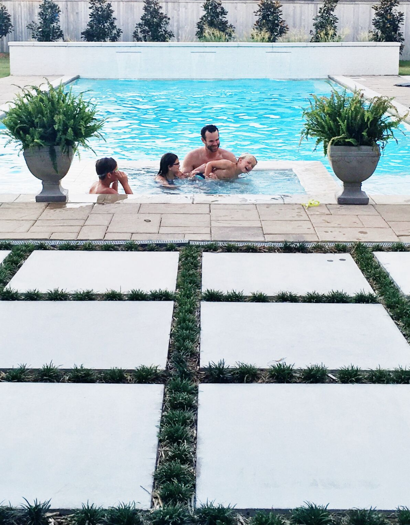 Father's Day Gift Guide concrete pavers with grass growing in between them rectangular pool