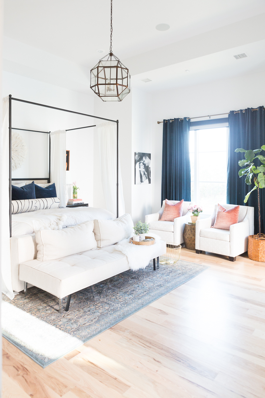 The Ultimate Guide to Affordable Canopy Beds master bedroom end of bed sofa navy and black master bedroom decor black wood master bedroom night stands gallery art master bedroom black gallery frames master bedroom fiddle leaf fig tree master bedroom juju hat over bed pink faux stems