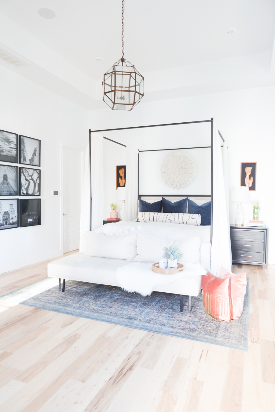 The Ultimate Guide to Affordable Canopy Beds master bedroom end of bed sofa navy and black master bedroom decor black wood master bedroom night stands gallery art master bedroom black gallery frames master bedroom fiddle leaf fig tree master bedroom