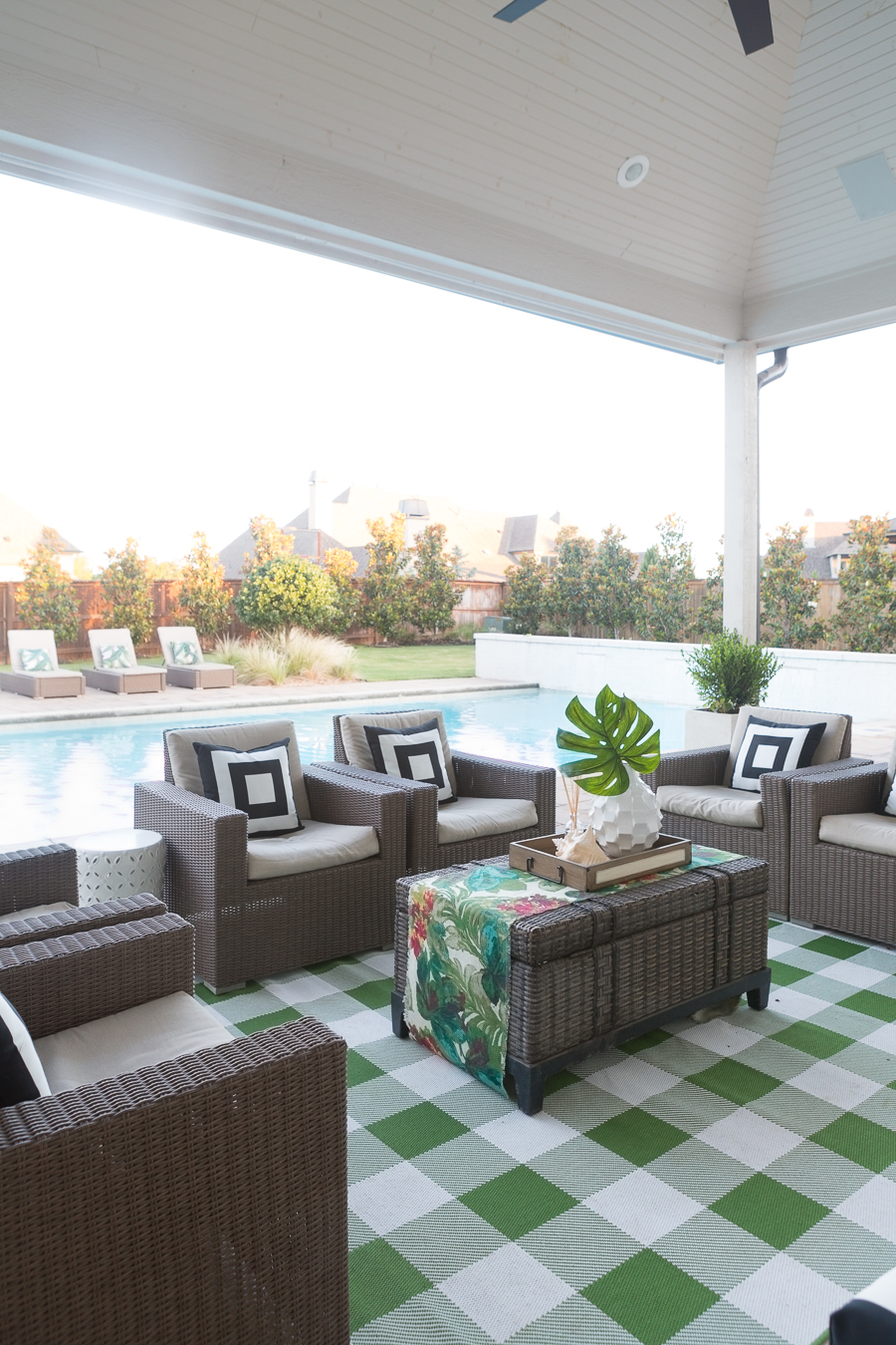 How to Design a Beautiful Pool and Outdoor Living Area buffalo check outdoor rug Target outdoor club chairs black and white outdoor pillows cement countertops outdoor living area decor ideas wicker pool lounger best affordable pool loungers