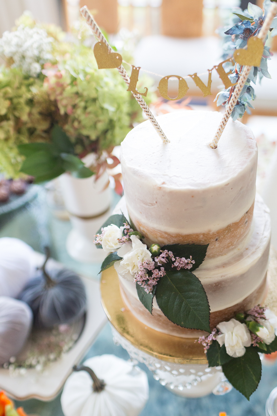 beautiful fall bridal shower ideas fall bridal shower cake on a white cake stand surrounded by