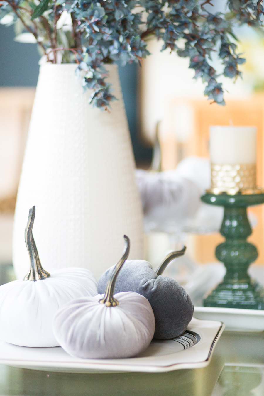 Loveliest Looks of Fall Home Tour Beautiful Fall Home Decor and Fall Fashion Ideas dining room fall tablescape with velvet pumpkins and a white large vase with faux green stems