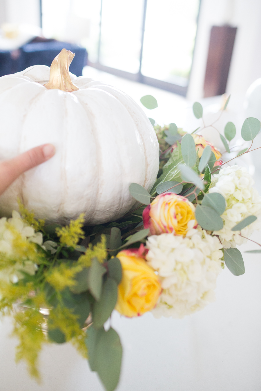 DIY Silver Urn Pumpkin Centerpiece for Fall floral sponges inside of a silver urn for a DIY fall centerpiece