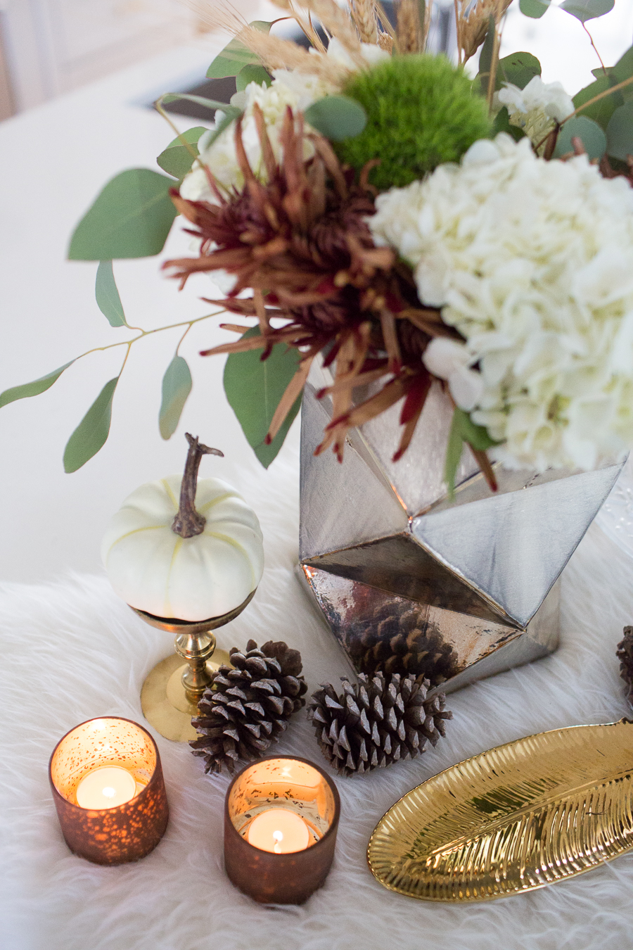 Simple Ways to Decorate for the Holidays from West Elm copper votive candles and pinecones