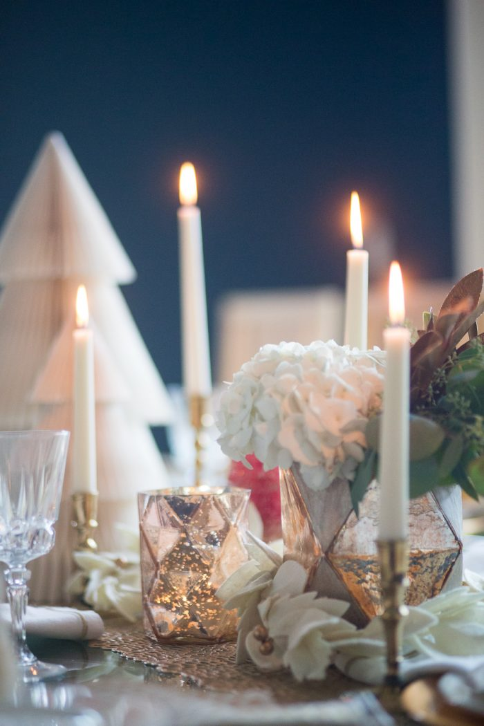 Budget Friendly Holiday Decor from Walmart Christmas tablescape with gold candlesticks and floral arrangements in a hexagon gold vase from West Elm