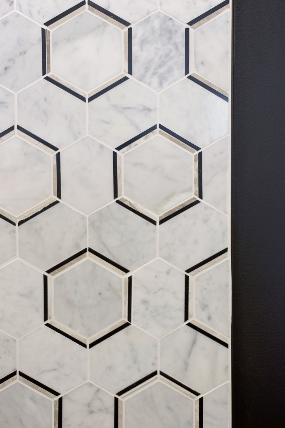 elite dance studio hexagon tiling behind front desk