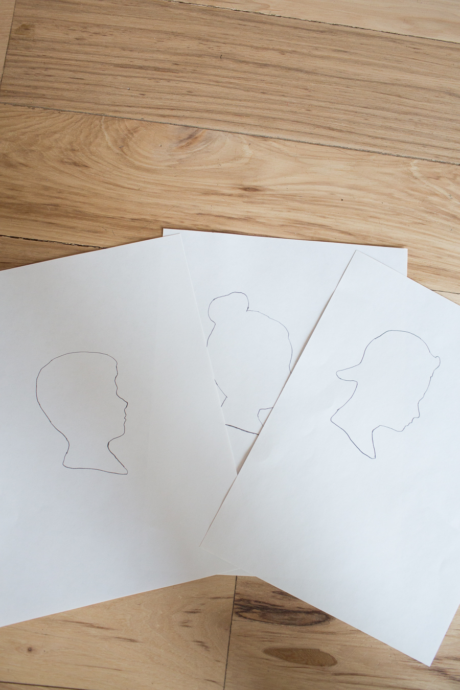 three different silhouette drawings