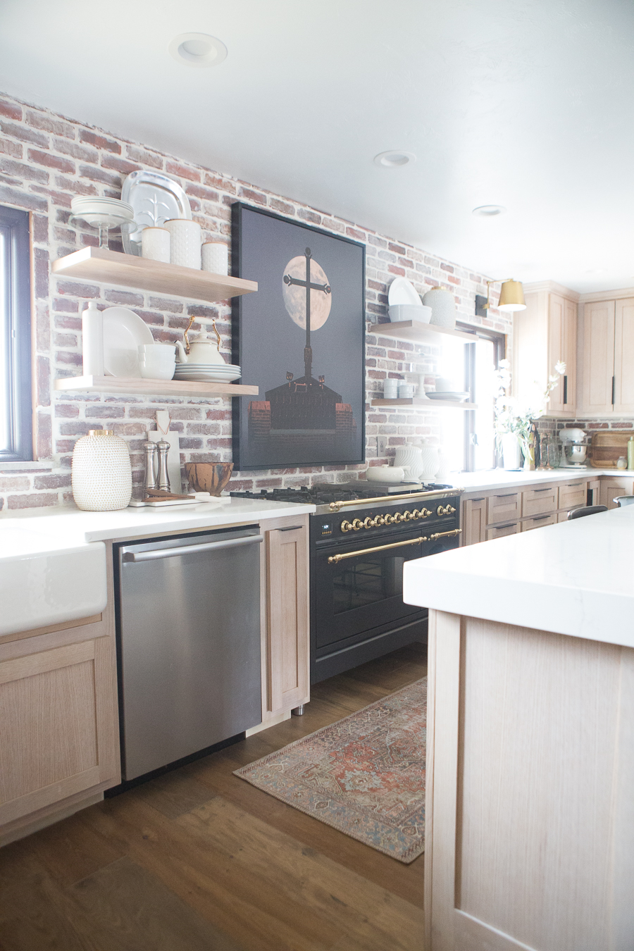 the kane project kitchen with brick featured wall