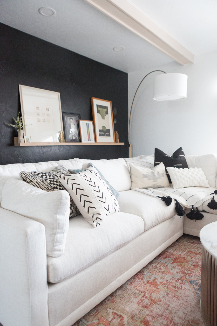 the kane project white wrap around couch in living room
