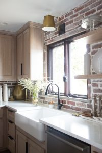 CC and Mike Kane Project Remodel Reveal rift sawn white oak wood kitchen cabinets with marble ountertops arteriors pendant lighting black hardware black stove with gold hardware loren kitchen runner