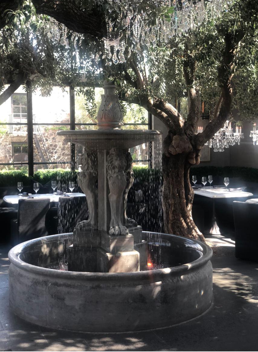 fountain with water inside restoration hardware restaurant