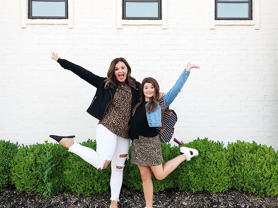 Back-To-School-with-Walmart-Part-Two-mother-and-daughter-in-leopard-shirt-and-skirt-with-jean-jackets-from-Walmart-in-front-of-a-white-brick-walmart