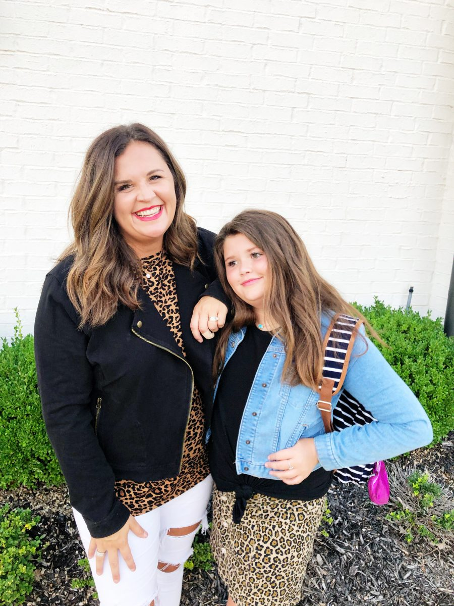 Back-To-School-with-Walmart-Part-Two-mother-and-daughter-in-leopard-shirt-and-skirt-with-jean-jackets-from-Walmart-in-front-of-a-white-brick-wall6