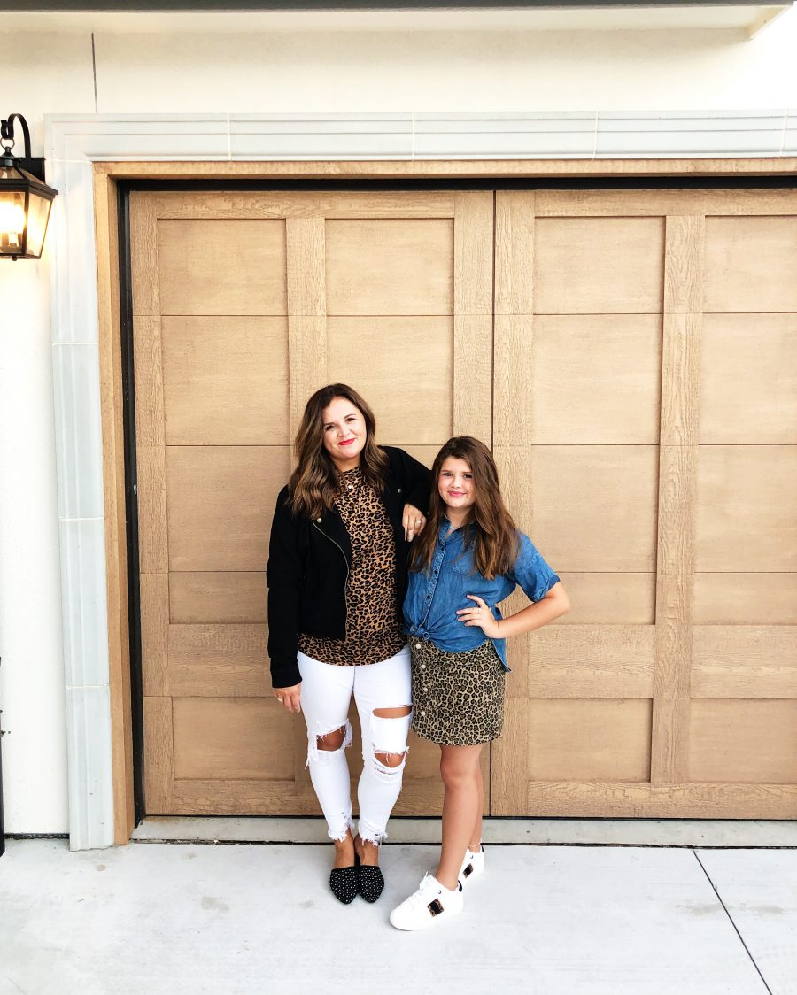 Back-To-School-with-Walmart-Part-Two-mother-and-daughter-in-leopard-shirt-and-skirt-with-jean-jackets-from-Walmart-in-front-of-a-white-brick-wal
