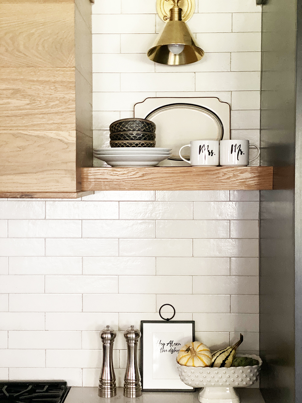 Affordable Fall Front Porch and Tabletop Decor Ideas wood vent hood with subway tile backsplash and fall decor kitchen styling with mr and mrs coffee mugs