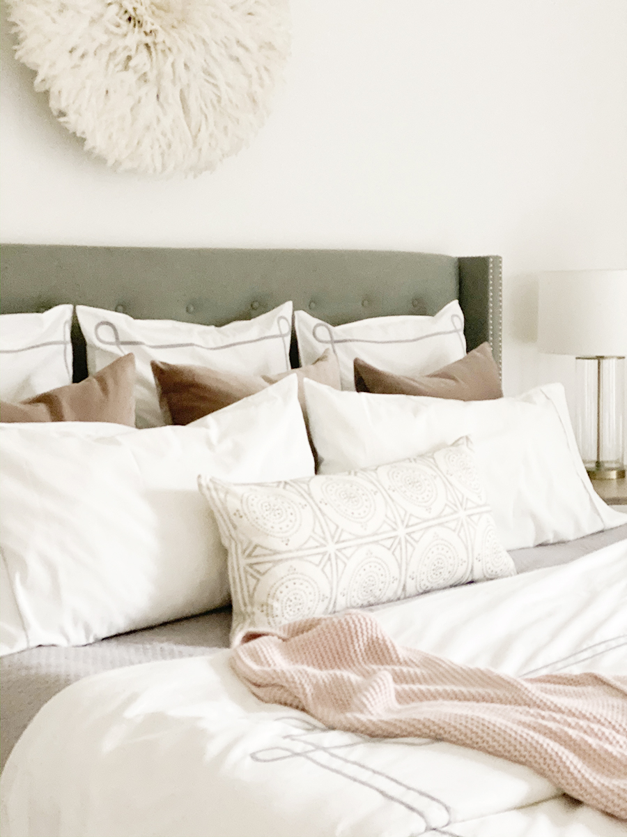 How to Get Your Guest Bedroom Holiday Ready Serena and Lliy Bedding Gray upholstered bed with wood bench and juju hat