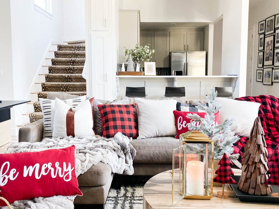 Affordable Buffalo Plaid Holiday Pillows and Decor buffalo plaid pillows and tabletop Christmas trees on a round wood coffee table-10