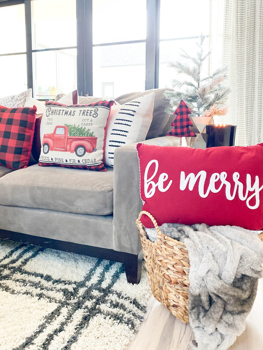 Affordable Buffalo Plaid Holiday Pillows and Decor buffalo plaid pillows and tabletop Christmas trees on a round wood coffee table-2