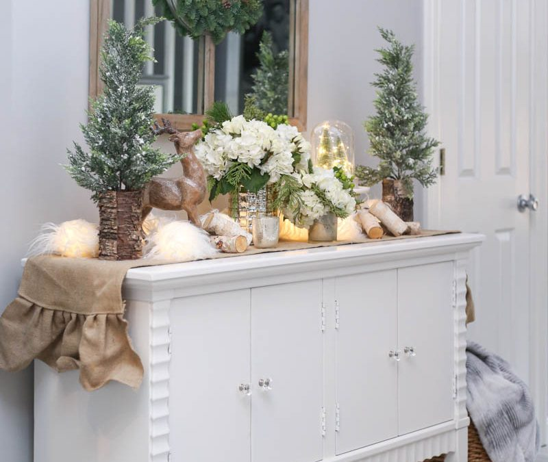 Black Friday and Cyber Monday Sales from Wayfair White Console with pine trees and christmas lights