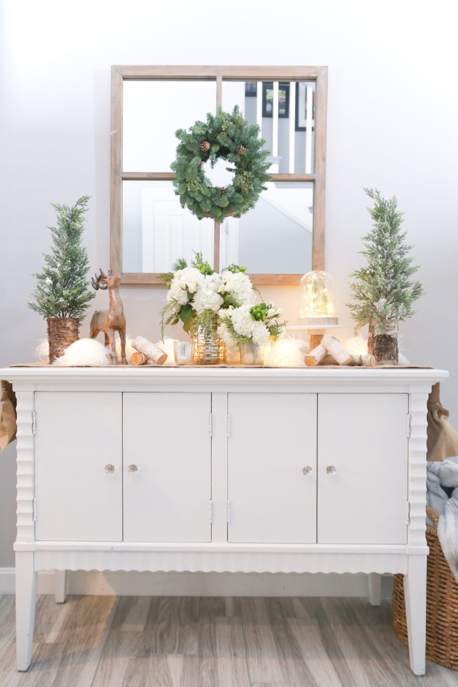 Black Friday and Cyber Monday Sales from Wayfair White console table with pine trees and reindeer and white hydrangea
