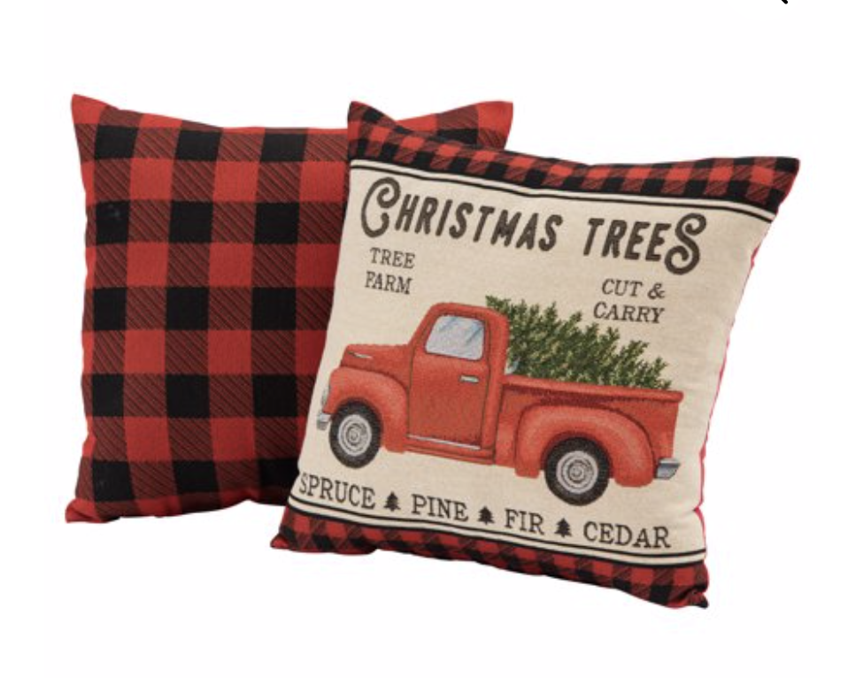 Affordable Buffalo Plaid Holiday Pillows and Decor buffalo plaid pillows and tabletop Christmas trees on a round wood coffee table-7