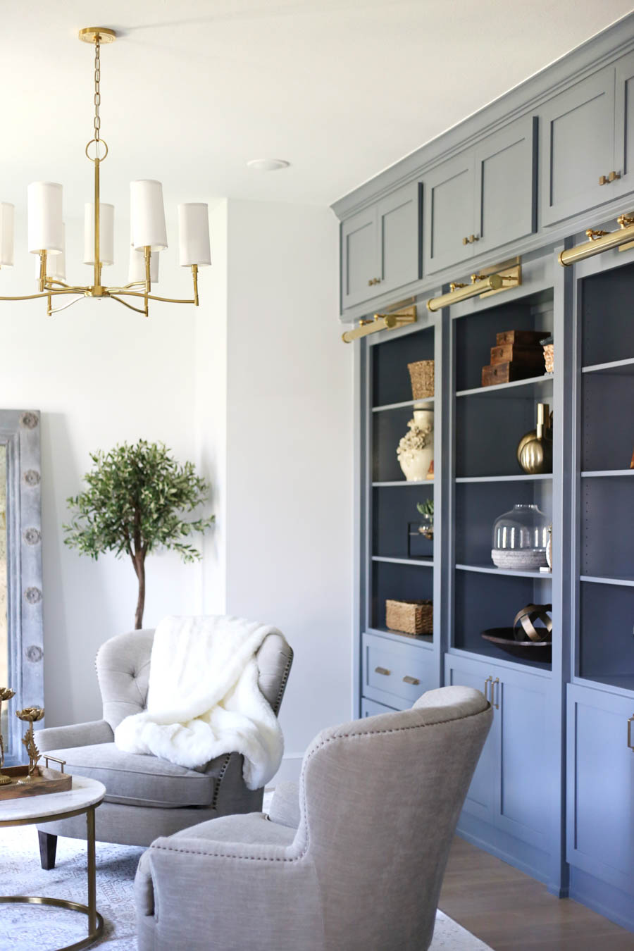 CC and Mike Frisco I Project Reveal-35 gray cabinets with open shelving gold library lighting and chandelier sitting room