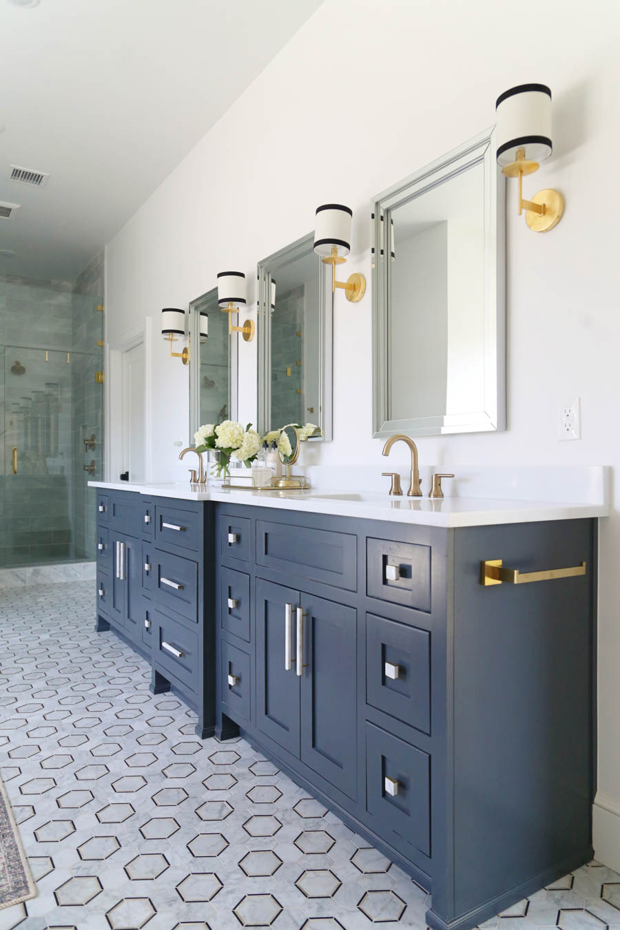 CC and Mike Frisco I Project Reveal-5 black marble hexagon floors with gray cabinets and marble and gold hardware
