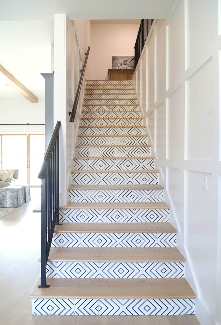 CC and Mike Frisco I Project Reveal-32 black and white ceramic patterned tile on wood stair case with black railing and white wood paneling
