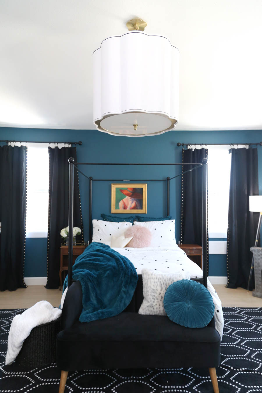 CC and Mike Frisco I Project Reveal teal Galapagos torquiest girls bedroom and bathroom design with black curtains and a black canopy bed and custom vogue womens art above the bed